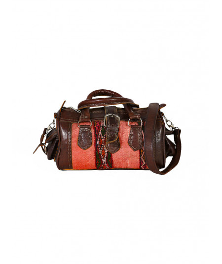 Travel bag in leather and kilim