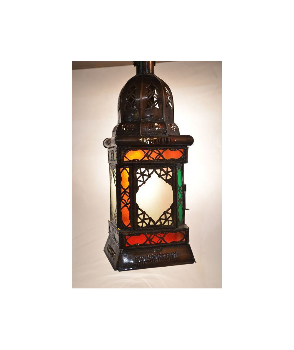 Tinted metal lantern inspired by the Arabian Nights colored wrought iron lantern.