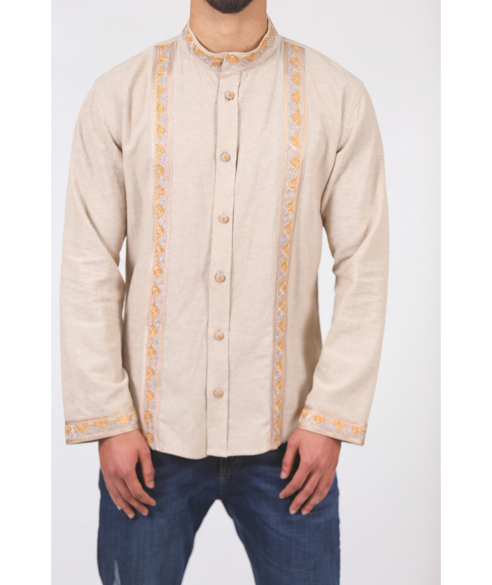 Beige shirt with orange embroidery