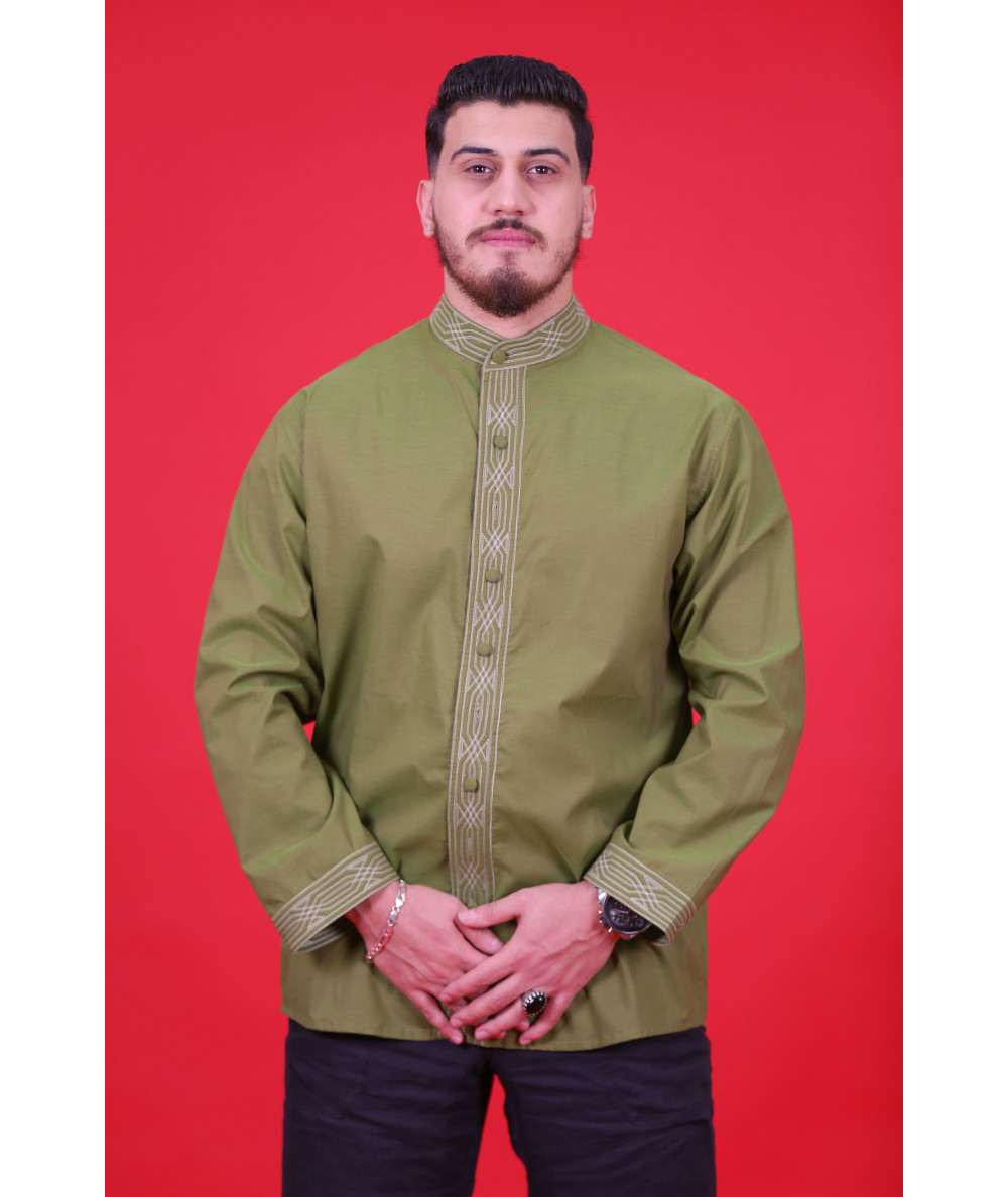 Green shirt embroidered in white thread