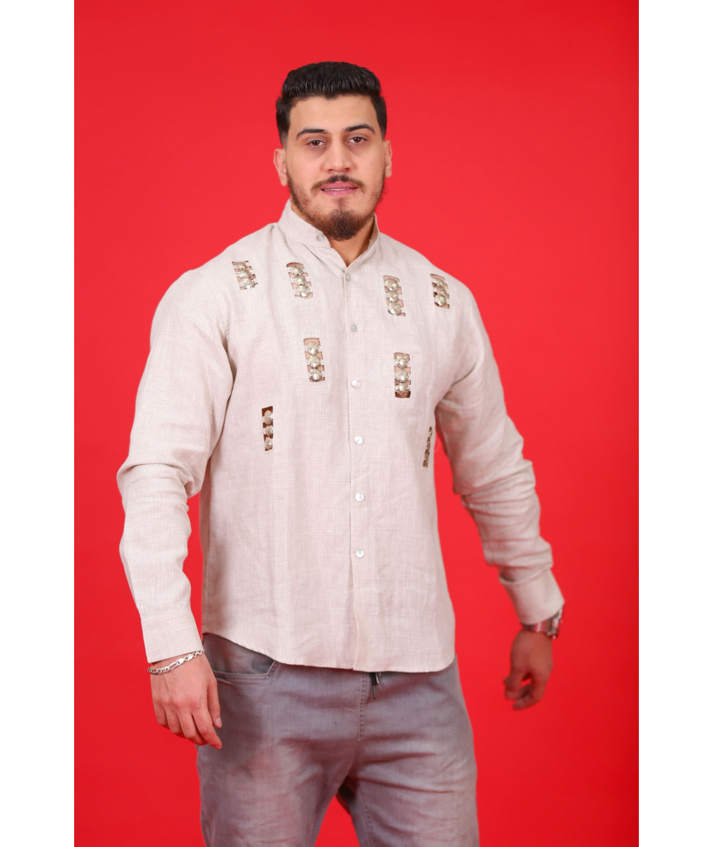 Beige printed shirt decorated with metal buttons