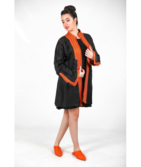 Black linen cape with orange glitter lining